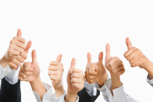 People raise their thumb up above over the white background